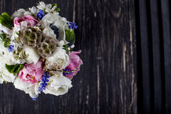 Pastel bouquet on dark old wood Stock Images