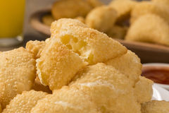 Pastel, a Brazilian snack, with a bar in the background. Cheese Royalty Free Stock Photo