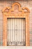 Pastel brick ornament traditional window and balcony spanish style with stucco decoration. Traditional window and balcony in spanish style with stucco and stock photos