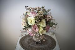 Pastel bridal bouquet. Beautiful bridal bouquet made of roses and decorative plants stock image