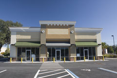Pastel brown strip mall Stock Image