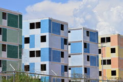 Pastel buildings under construction. Sample of several buildings in multiple pastel colors like green, blue, yellow and orange. these housing units are built to Stock Images