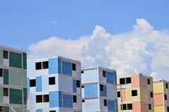Pastel buildings under construction. Sample of several buildings in multiple pastel colors like green, blue, yellow and orange. these housing units are built to Royalty Free Stock Images