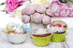 Pastel cake pops, cupcakes and marshmallows on rustic wooden tab Royalty Free Stock Photo
