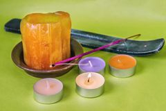 Pastel candles, incense and smoke Royalty Free Stock Photos