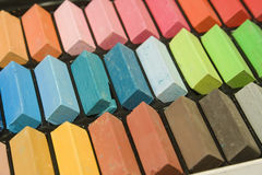 Pastel chalk. Rows of pastel colored chalk in a chalk tin royalty free stock photography
