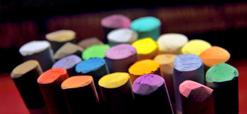 Pastel chalks. For drawing and painting on a dark background Royalty Free Stock Images
