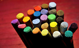 Pastel chalks. For drawing and painting on a red background Royalty Free Stock Images