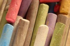 Pastel chalks in heap Royalty Free Stock Image