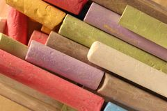 Pastel chalks in heap Stock Photo
