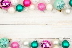 Pastel Christmas bauble double border over white wood royalty free stock photography