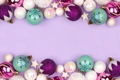 Pastel Christmas bauble double border over purple royalty free stock photos