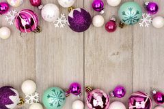 Pastel Christmas bauble double border on rustic white wood stock photo