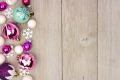 Pastel Christmas bauble side border on rustic white wood stock image