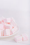 Pastel close-up sweets. Pink and white soft marshmallow on plate Stock Photography