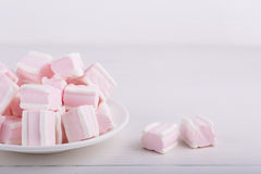 Pastel close-up sweets. Pink and white soft marshmallow on plate Royalty Free Stock Image