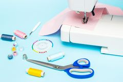 Pastel color background, Dressmaker and designer desk, Handcraft accessories. Threads roll, scissors and pins.  royalty free stock photos