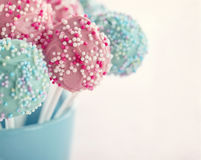Pastel color cake pops. In a blue cup with hazy vintage editing royalty free stock photography