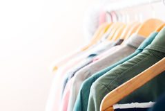 Pastel Color Clothes. Female Dresses on Clothes Rail Royalty Free Stock Photo