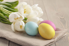 Pastel color easter eggs with tulips on table Royalty Free Stock Photo