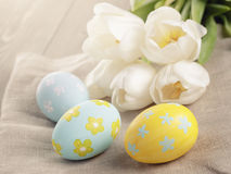 Pastel color easter eggs with tulips on table Stock Photography