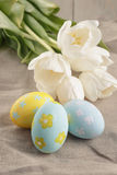 Pastel color easter eggs with tulips on table Stock Images