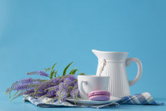 Pastel color macaroon with coffee on blue background Stock Photo