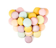 Pastel color macaroons laid out in form of heart Stock Image