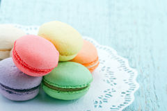 Pastel color macaroons on blue background Stock Photos