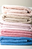 Pastel color stack of towels on a table Stock Images