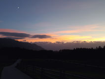 Pastel Color Sunset Sky with the Crescent Moon over the Country Road in Bavaria Royalty Free Stock Images