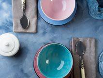 Tableware for breakfast or lunch on blue Royalty Free Stock Photo