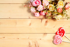 Pastel color tone  roses flowers with heart shape candy on woode Stock Photos