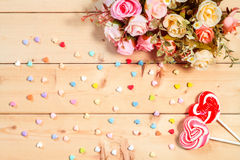 Pastel color tone  roses flowers with heart shape candy on woode Royalty Free Stock Photos