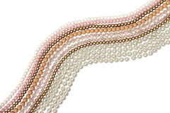 Beads. Pastel colored bead and pearls on a white background Royalty Free Stock Photo