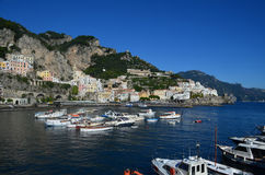 Pastel Colored Buildings Lining a Cove Along the Amalfi Coast. Italy`s iconic pastel colored buildings lining a cove along the Amalfi Coast Royalty Free Stock Image