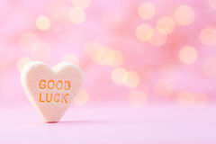 Pastel colored candy hearts in a bokeh background. Royalty Free Stock Photos