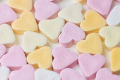 Candy hearts as background. Pastel colored candy hearts, macro photo as background picture stock photography