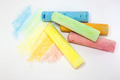 Pastel colored chalk sticks on a white background Stock Photos