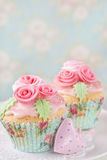 Pastel colored cupcakes Stock Photography