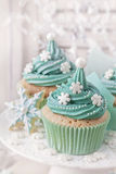 Pastel colored cupcakes Stock Photos