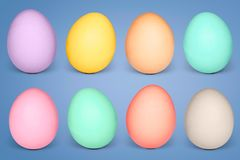 Pastel colored easter eggs against blue background. Bright colored Pastel easter eggs against blue background Stock Photography