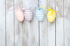 Pastel colored easter eggs over rustic wooden background. Royalty Free Stock Photography