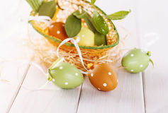 Pastel colored Easter eggs over white wooden background Stock Images