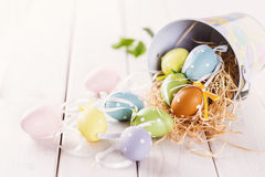 Pastel colored Easter eggs over white wooden background Royalty Free Stock Photo