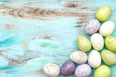 Pastel colored easter eggs on wooden background Royalty Free Stock Image