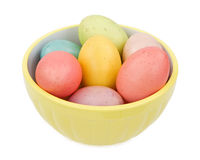 Pastel colored Easter eggs in a yellow bowl Stock Photos