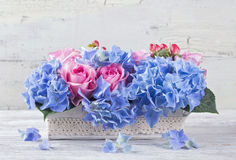 Pastel colored flowers. In a vase royalty free stock photos