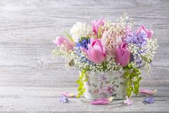 Pastel colored flowers. In a vase stock image