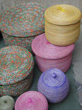 Pastel colored hand woven baskets Stock Photos